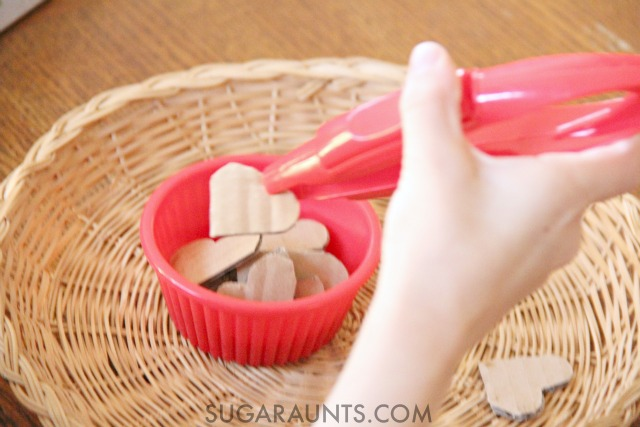 Hand-Eye Coordination Valentines Heart activity for math activities with Kindergarten kids or any school aged child. These jumbo tongs are great for visual motor integration skills and recommended by an Occupational Therapist.