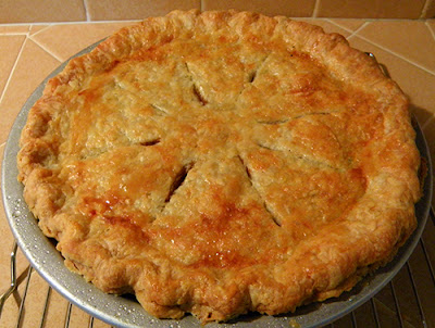 Whole golden brown pie fresh from the oven