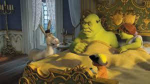 Shrek and Fiona in bed talking to the donkey
