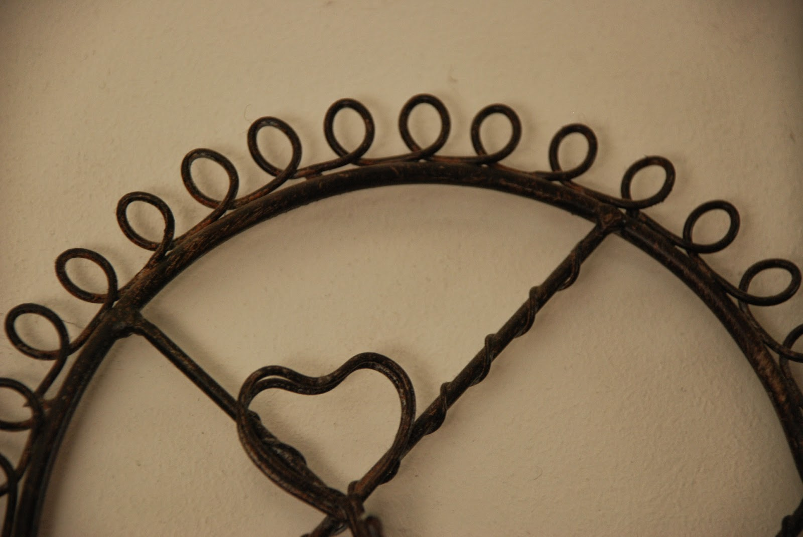 image of close up of metal heart memo holder