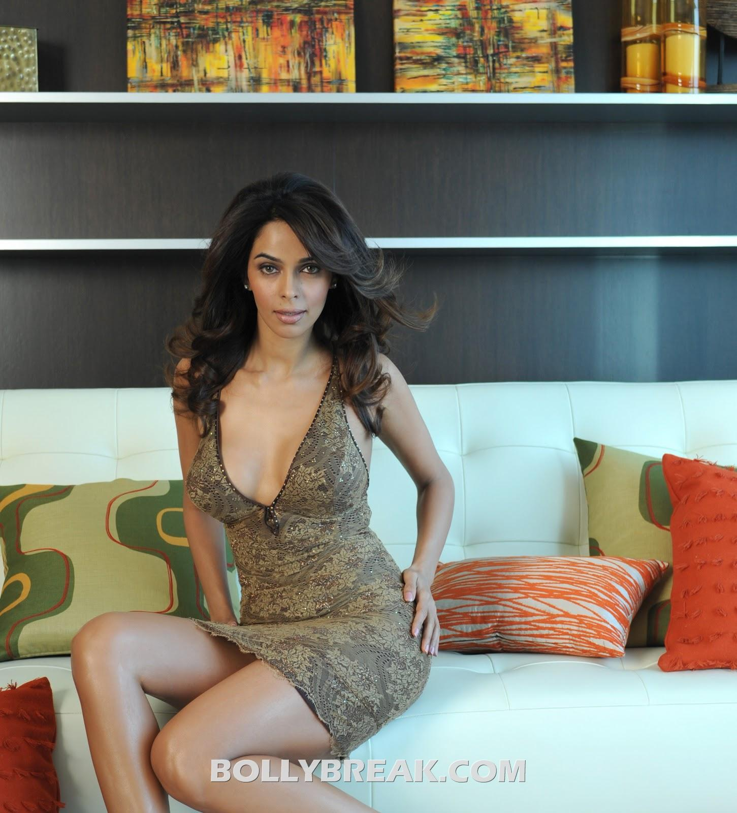 Mallika Sherawat sitting on sofa in hot brown dress - Mallika Sherawat Hot Wallpaper on Sofa