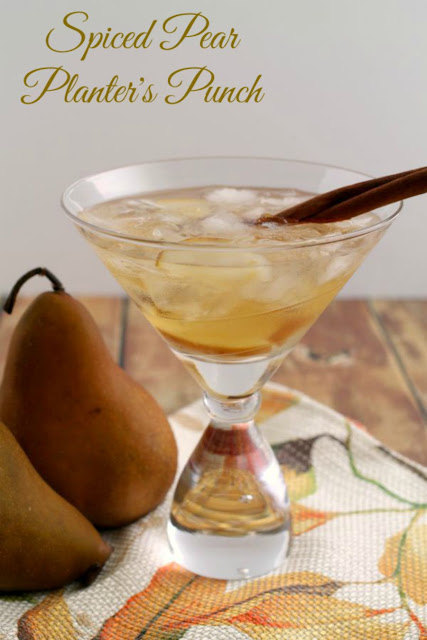 Sweet fresh pears and spiced rum come together in this perfect for fall Spiced Pear Planter's Punch.