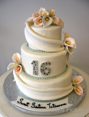 sixteen cake decorated with white fondant drapes and sugar Calla Lilies