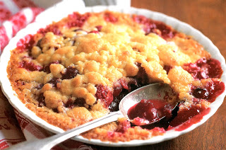 Classic pudding of a cranberry and orange stewed fruit base topped with a German streusel topping before oven baking. Served from the baking dish.
