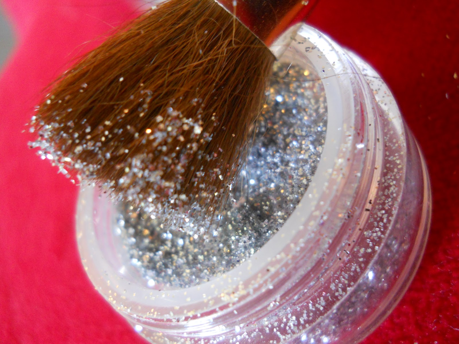 The brush will help the glitter fade out into a gradient on its own
