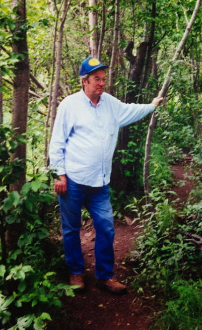 Bill Cooper in the woods surrounding his home in Eagar, Arizona