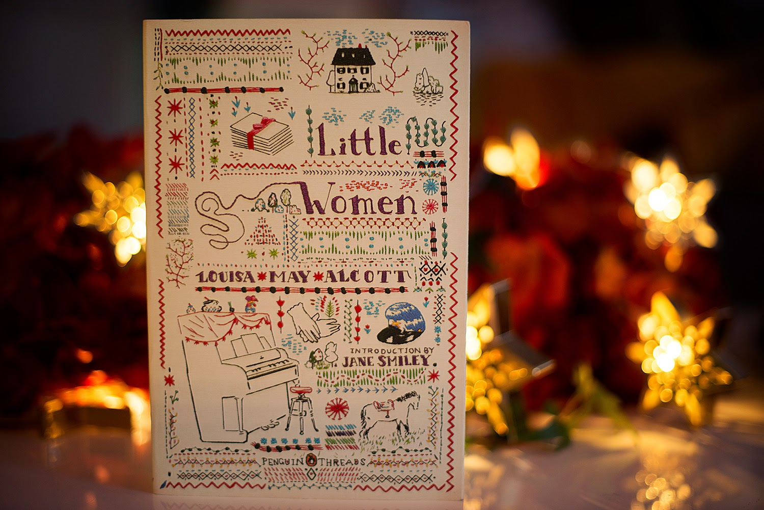 Book Review  Little Women by Louisa May Alcott     one woman s library photo of Joy Weese Moll with The Little Women book