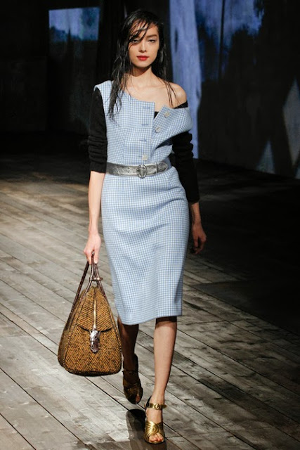 Model from Prada's Fall 2013 show wearing a blue gingham dress