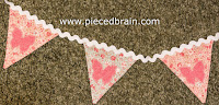 http://www.piecedbrain.com/2015/06/banner-with-applique-tutorial.html