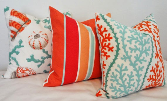 Turquoise and orange colored pillows