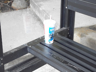 Disposable cup on bus shelter bench
