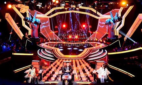 The Voice Kids stage with the three coaches