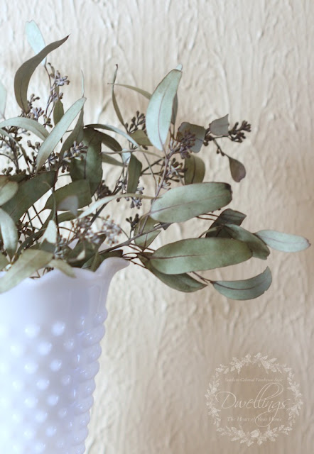 Dried seeded eucalyptus used in a floral arrangement.