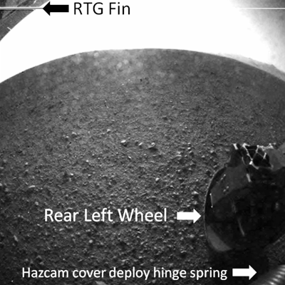 Curiosity MSL lands on Mars. Curiosity camera showing her rear-left wheel firmly on Martian ground. 6 August 2012. NASA/JPL.