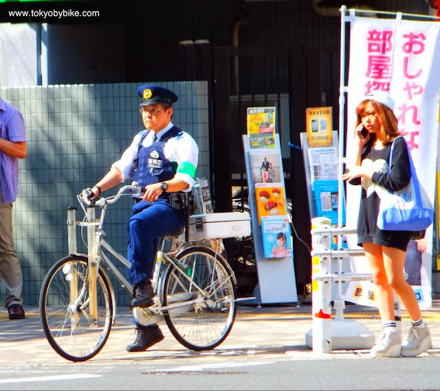 Policeman on a bicycle in Tokyo, Japan