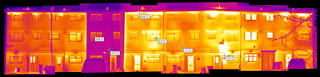 Thermal image of Passivhaus retrofit in a terrace, taken in January 2012, showing how much less heat it is leaking compared to its neighbours. Pic: bere:architects