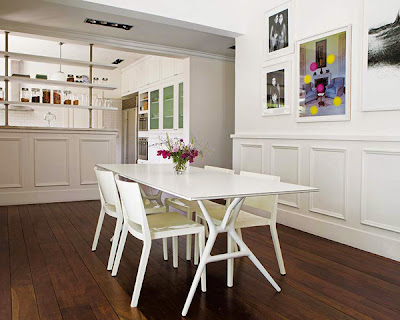 white dining room with wood floor base the pops of attractive wall decorations