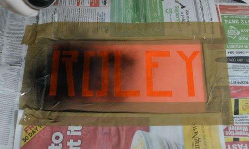 Spraying custom stencil.
