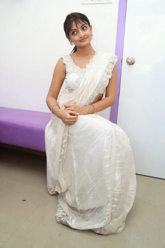 Nikitha narayan photos in white saree at homeo trend super speciality hospital launch