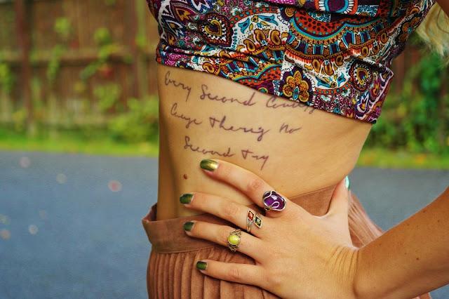 rib tattoo text