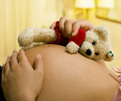 Teddy Bear and pregnant woman