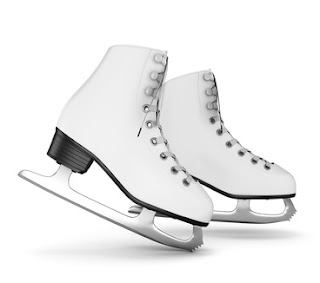 Pic of white, professional ice skating boots