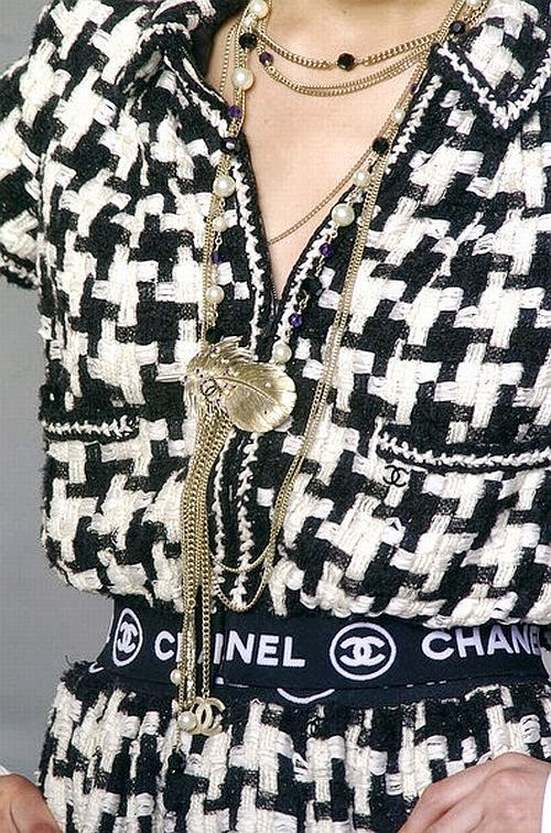 Chanel runway details: black and white tweed and gold necklaces