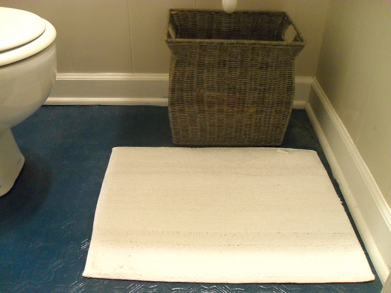 the remodeled painting a bathroom floor