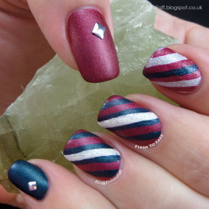 Red and Green candy cane nail art design.