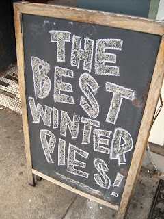 The Tuck Shop sign reads The Best Winter Pies