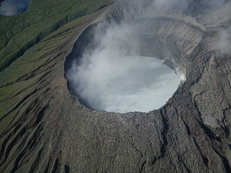 Rincon de la Vieja Volcano Costa Rica spews a column of vapor and gases reaching more than 700....
