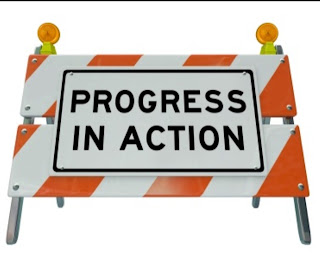 progress in action caution sign