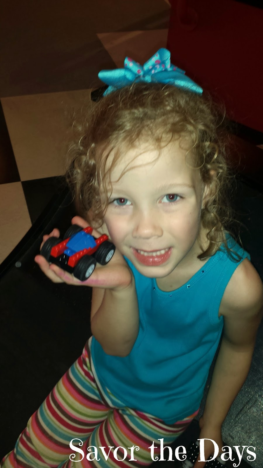 Girl with Lego car at Legoland Discovery Center in Grapevine