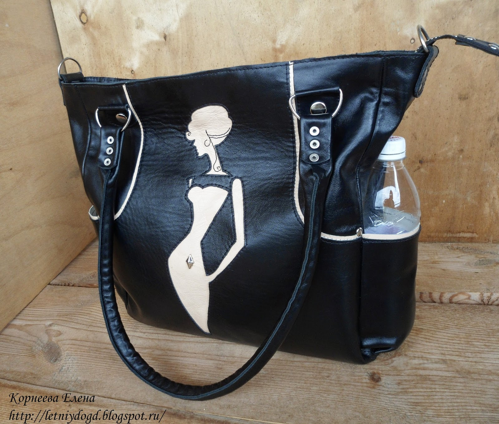 большая черная кожаная женская сумка