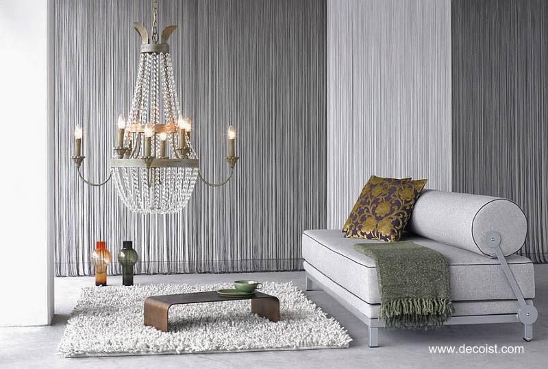 Sala contemporánea con una variedad de texturas de textiles