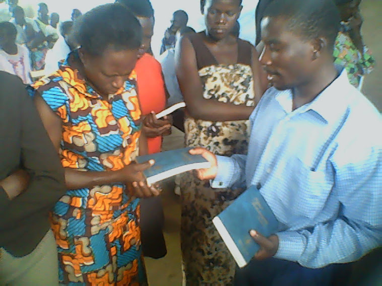 Sister Oliver Malaba uganda..Recieving a bible,just in prayer.