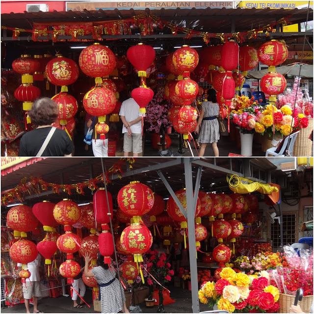 Red lanterns and Chinese plastic flowers are sold in the markets in Kuala Lumpur, Malaysia