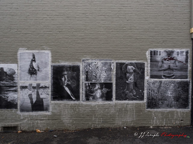 Pasted images on gray wall