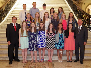 Senator Ross on left, Representative Roy on right with HMMS students