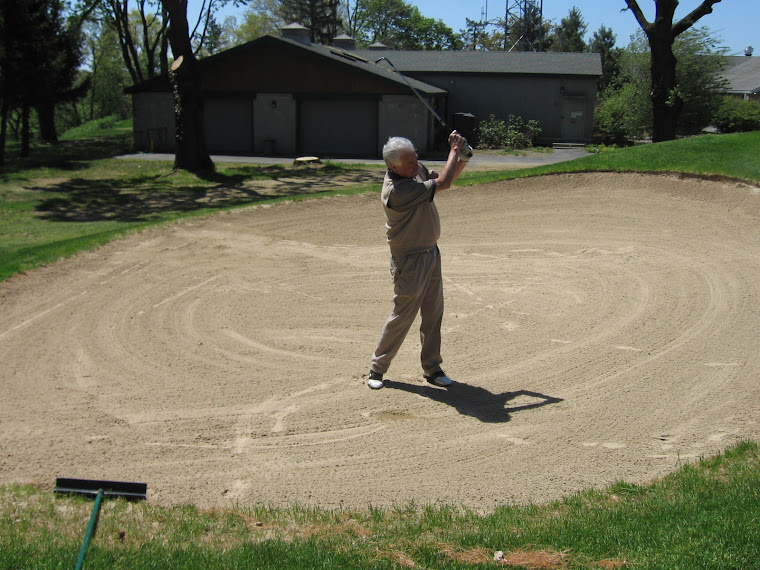 Joe Peters Splashes Sand from the Left Bunker at #18