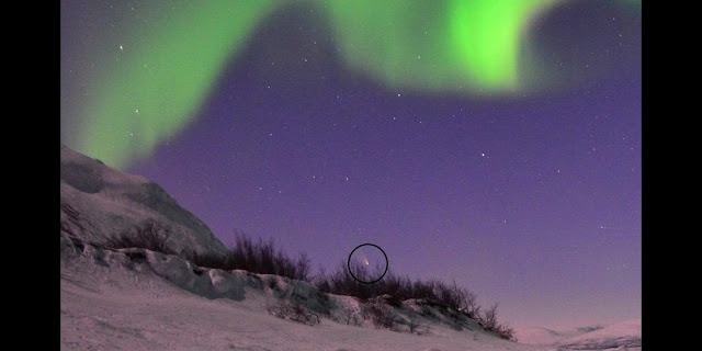 This closeup from Chad Blakley's video uses a black circle to highlight the comet's location. For more, check out Blakley's Lights Over Lapland page on Facebook. Credit: Chad Blakley / Lights Over Lapland