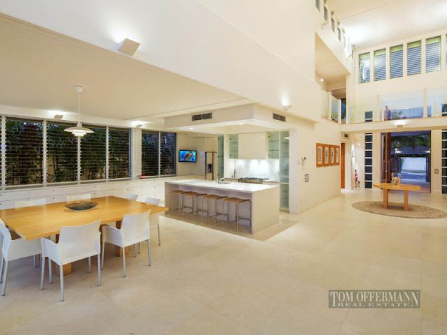 Photo of modern kitchen and dining room in beautiful waterfront villa
