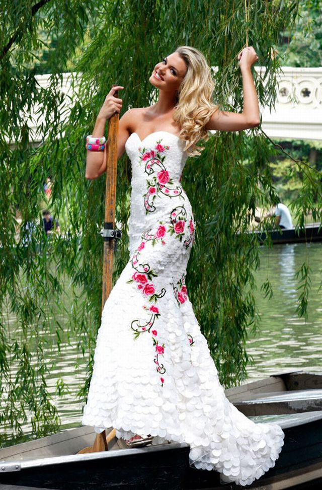 white strapless sweetheart prom dress with red flower design