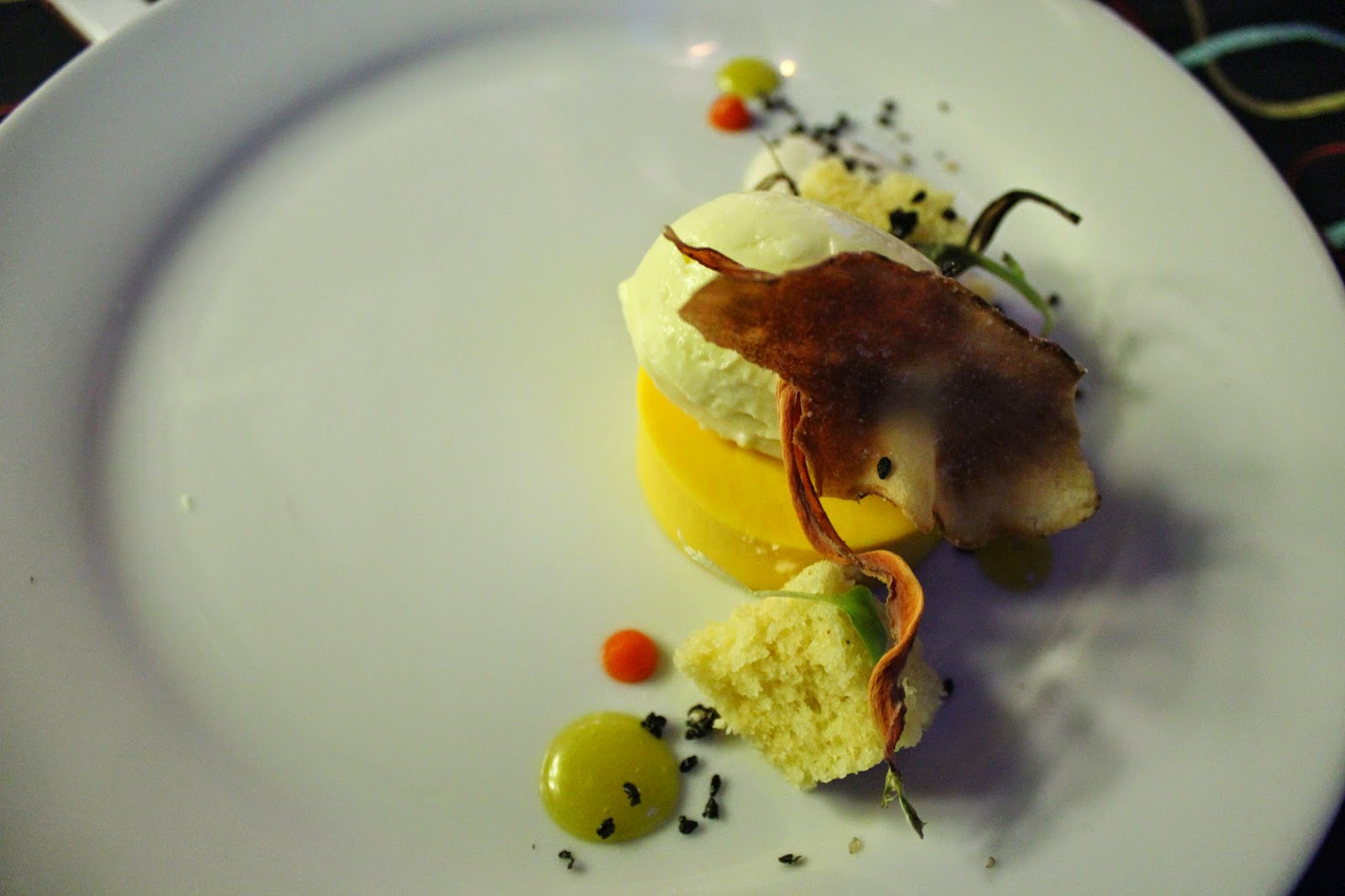 Carrot panna cotta with quinoa cake, sunchoke vanilla puree, and fresh ginger cream