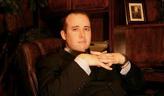Travis Alexander full of life, poses in business suit