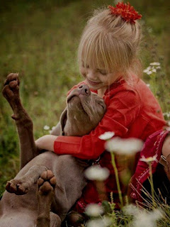 little girl and dog love