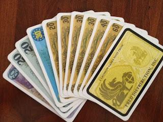 A hand of bills in Reiner Knizia's Money