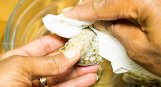 Hand Cleaning Oyster with Paper Towel.