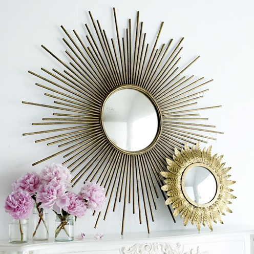 Two Sunburst Mirrors for Home Decor on Mantle