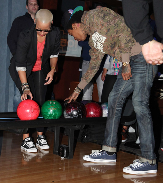 wiz khalifa and amber rose bowling. wiz khalifa amber rose tatted.